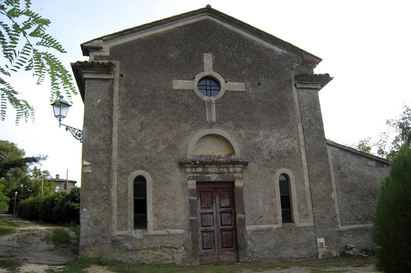 Church outside village walls